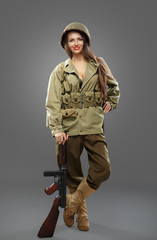 Sexual Girl soldier with tommy gun.