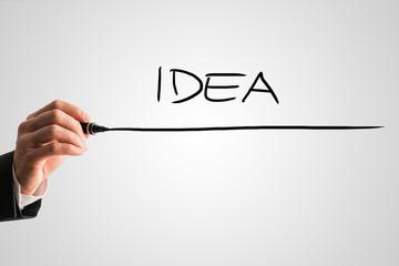 Man writing the word Idea