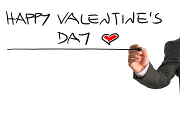 Man writing Happy Valentines day with a red heart at the end