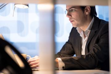 Businessman sitting working at his desk