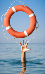 Lifebuoy for man in danger. Rescue situation concept.