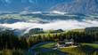 Morning fog in the Austrian Alps during an autumn season