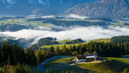 Morning fog in the Austrian Alps during an autumn season