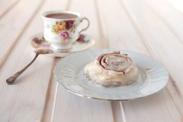 cinnamon roll and tea