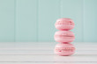 A stack of macarons (macaroon) on a white wooden table. Vintage - 76910990