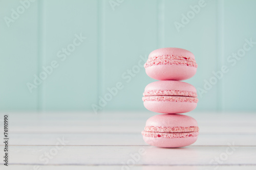 A stack of macarons (macaroon) on a white wooden table. Vintage