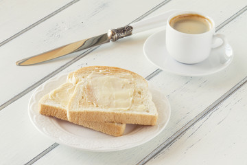 A delicious breakfast of butter toast and coffee