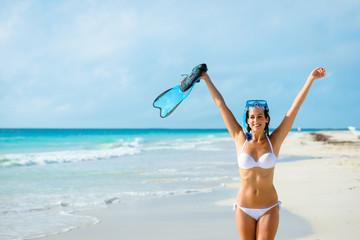 Joyful woman on tropical beach snorkelling