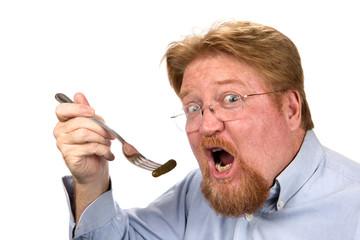 Man Eating Pickle On Fork