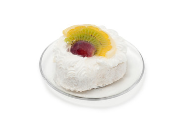 White cake with fruit on plate