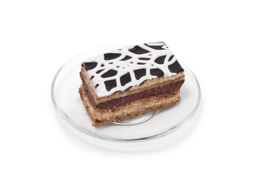 Biscuit cake with white cream on plate