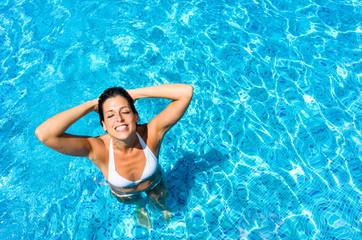 Woman having fun and relaxing in swimming pool