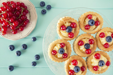 Some vol-au-vent with blueberries and red currants. Vintage.