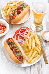 fast food - hot dog with French fries, beer and snacks