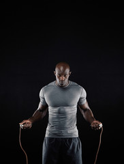 Masculine african man skipping rope