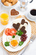 fried eggs in the form of heart for breakfast Valentine's Day