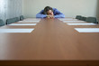 businessman sleeping on table in office