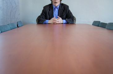 businessman sitting on table in office