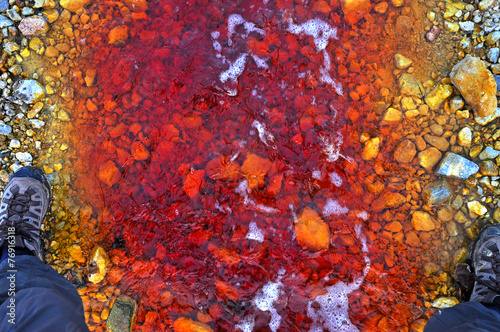 Red polluted water stream in Geamana, Romania - 76916318