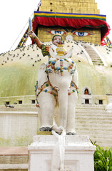 Sculpture of warrior on the elephant protects the huge Stupa