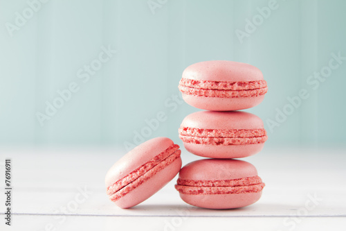 Fototapeta Strawberry macaroons (macarons). White table. Vintage Style