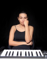 emotional woman learning to play the piano.