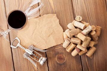 Wine glasses, corks, corkscrew and piece of paper