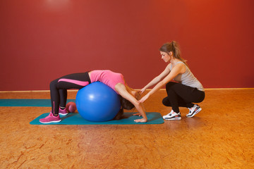 Fitness Training - woman with medicine ball help each other
