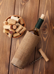 White wine bottle, corks and corkscrew