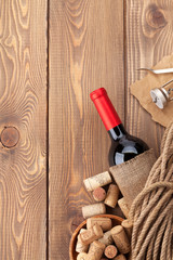 Red wine bottle, corks and corkscrew