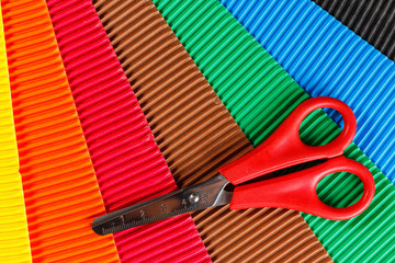 scissors on colorful cardboard