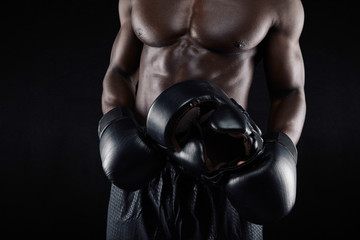 African male boxer relaxing after workout