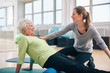 Physical therapist working with a senior woman at rehab - 76918748
