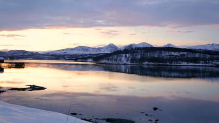 Scandinavian panning view Norwegian winter Fjord snow fading daylight
