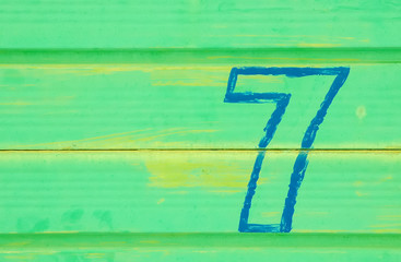 number seven on a green background