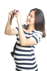 Attractive smiling pregnant woman taking a photo