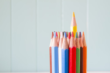 Colored pencils. An outstanding pencil. Concept: leadership