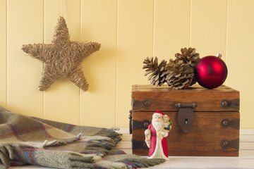 Christmas scene: a star, Santa, a blanket, a ball and pinecones