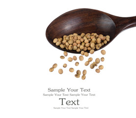 soybeans on wooden spoons top view close up isolated on white