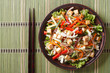 Asian salad with tofu and fresh vegetables horizontal top view