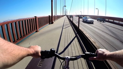 POV Bicycle rider San Francisco Bay Golden Gate Bridge traffic  USA
