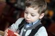 Kid drinking red juice