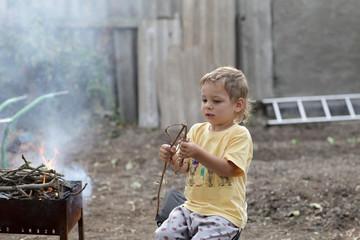 Child preparing barbecue