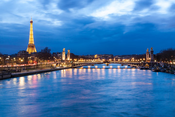 Pont Alexandre III, Paris at dusk with tower.