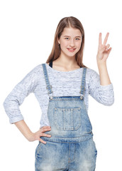 Happy young teenager girl showing victory gesture isolated