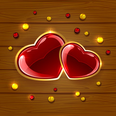 Hearts and beads on wooden background