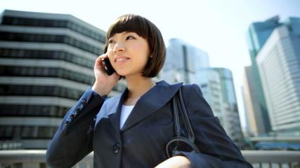 Ethnic Asian Japanese Woman Outdoors Smart Phone City Buildings Sun Lens Flare