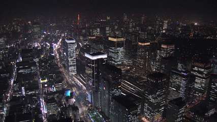 Aerial Metropolis illuminated skyscrapers Tokyo Station Business District Japan