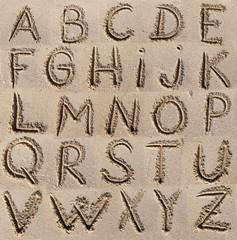 Alphabet (ABC) written on sand.