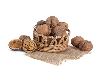 Walnuts in basket isolated on white